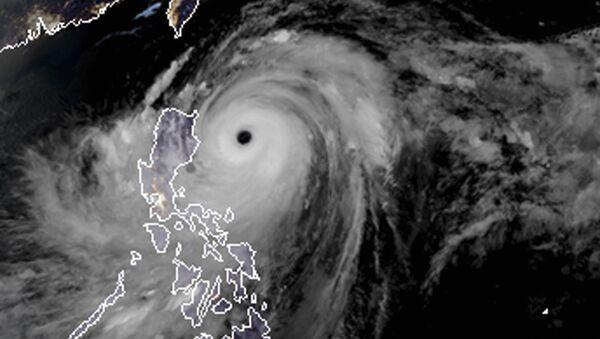Snimak iz satelita tajfuna Mangkut koji je pogodio Filipine - Sputnik Srbija