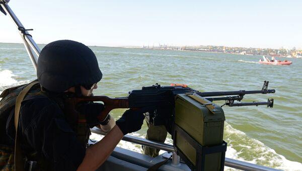Припадник украјинске обалске страже на Азовском мору - Sputnik Србија