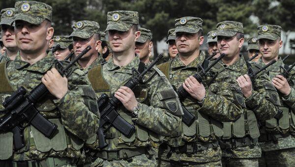 Припадници Безбедносних снага Косова на церемонији прославе Ослободилачке војске Косова у Приштини - Sputnik Србија