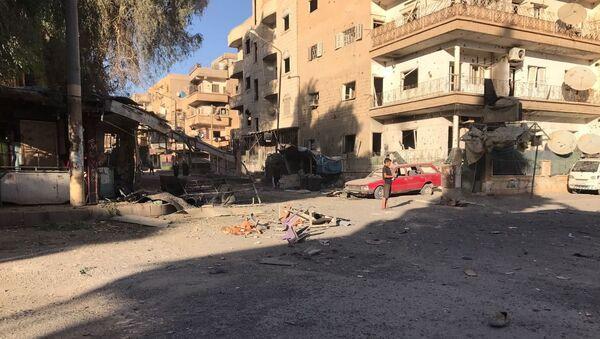 Posledice raketnog napada na četvrt El Kusur u sirijskom gradu Dejr el Zor - Sputnik Srbija