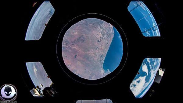 Аномалија у свемиру забележена камером са МСС-а. - Sputnik Србија