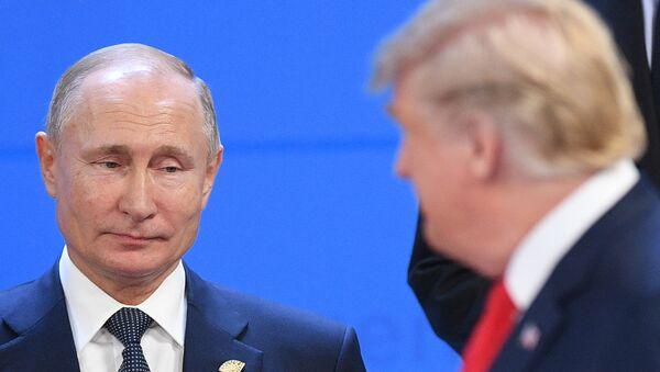 Председник Русије Владимир Путин и председник САД Доналд Трамп на самиту Г20 у Аргентини - Sputnik Србија