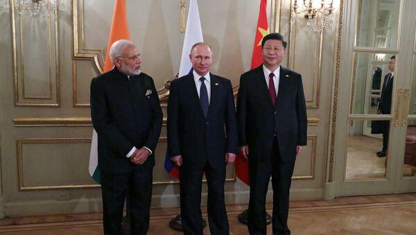 Председник Русије Владимир Путин, председник Кине Си Ђинпинг и премијер Индије Нарендра Моди - Sputnik Србија