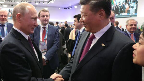 Председник Русије Владимир Путин и председник Кине Си Ђинпинг - Sputnik Србија