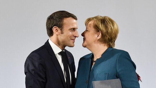 Angela Merkel i Emanuel Makron - Sputnik Srbija