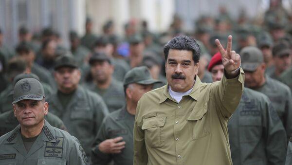 Pristalice predsednika Venecuele Nikolasa Madura na mitingu podrške u Karakasu - Sputnik Srbija