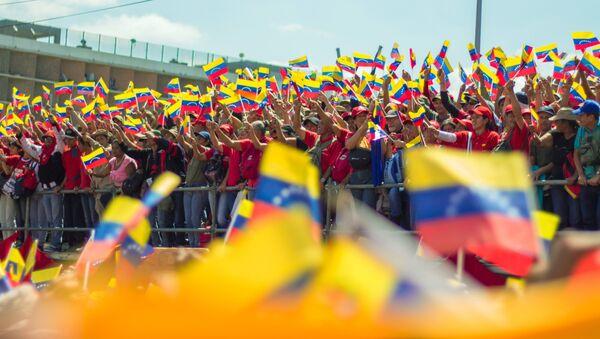 Pristalice predsednika Venecuele Nikolasa Madura na mitingu u Karakasu - Sputnik Srbija