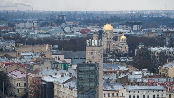 Кула са часовником и црква Рођења Христовог у Риги - Sputnik Србија