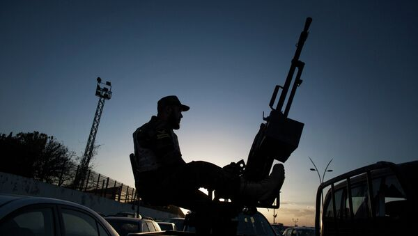 Pripadnik libijske vojske u vojnoj bazi Navasin u okrugu Suk el Džuma - Sputnik Srbija