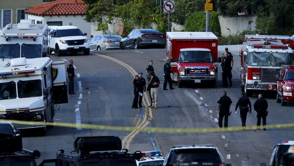 Police and fire personnel are seen at the scene of an active shooting with a suspect with a high powered rifle in the Bankers Hills section of San Diego, California, November 4, 2015. - Sputnik Србија