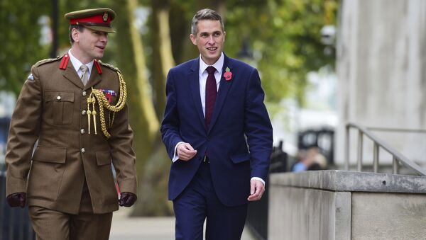 Gavin Williamson, right, outside the Ministry of Defence in London after he was named as the new Secretary of State for Defence following the resignation of Sir Michael Fallon who admitted his behaviour had fallen below the high standards required in the role, Thursday, Nov. 2, 2017. - Sputnik Србија