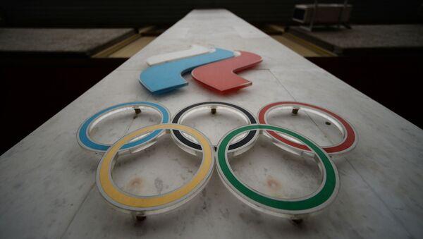 Олимпијски кругови на згради Олимпијског комитета Русије у Москви - Sputnik Србија