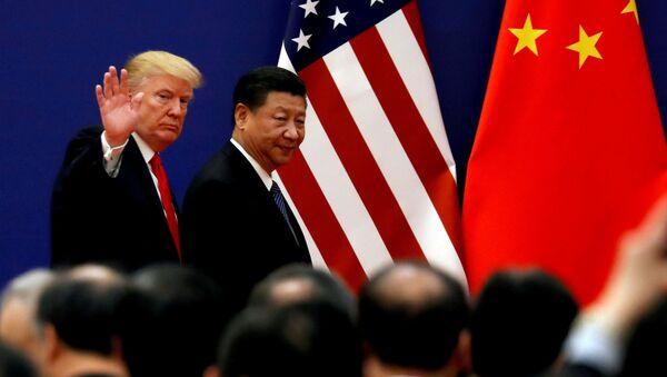 Председници САД и Кине, Доналд Трамп и Си Ђинпинг, на састанку у Пекингу - Sputnik Србија