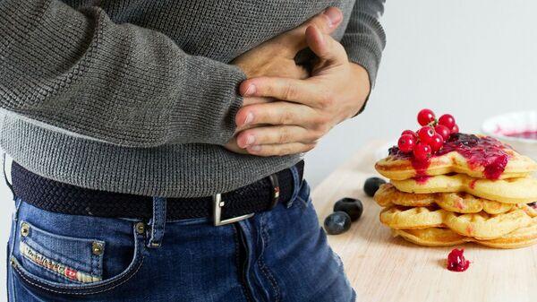 Bolovi u stomaku zbog loše hrane - Sputnik Srbija