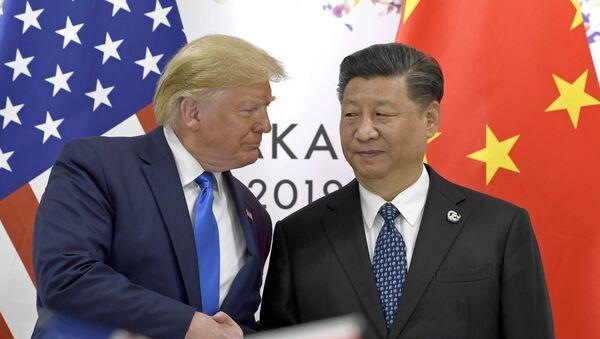 Амерички председник Доналд Трамп са кинеским лидером Си Ђинпингом - Sputnik Србија