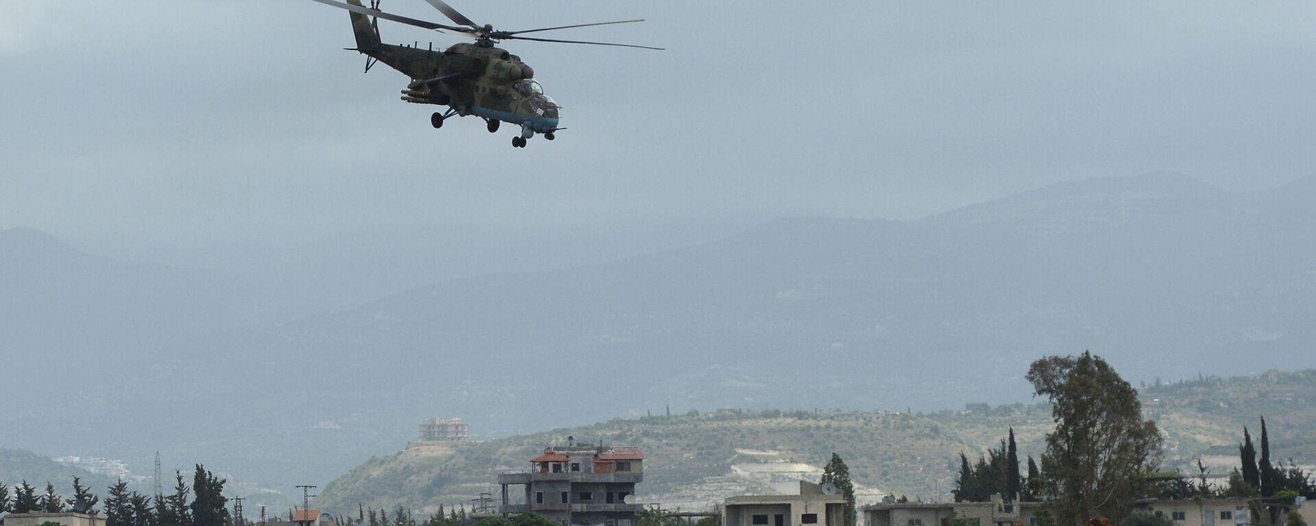 Ruski helikopter Mi-35 obleće aviobazu Hmejmim u Siriji - Sputnik Srbija, 1920, 27.09.2021