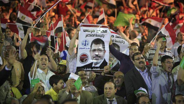 Присталице бившег египатског председника Мухамеда Морсија на једном од протеста - Sputnik Србија