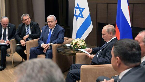 Председник Владимир Путин и израелски премијер Бењамин Нетанијаху - Sputnik Србија