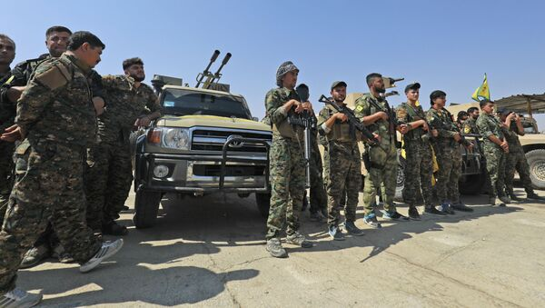 Припадници Снага самоодбране сиријских Курда у граду Шадади, 60км јужно од града Хасака у Сирији - Sputnik Србија