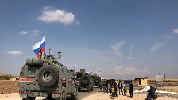Oklopna vozila ruske vojne policije u Kobaniju na sirijsko-turskoj granici - Sputnik Srbija