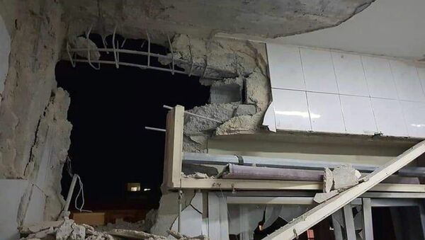 Zgrada oštećena u vazdušnom napadu Izraela na Siriju - Sputnik Srbija