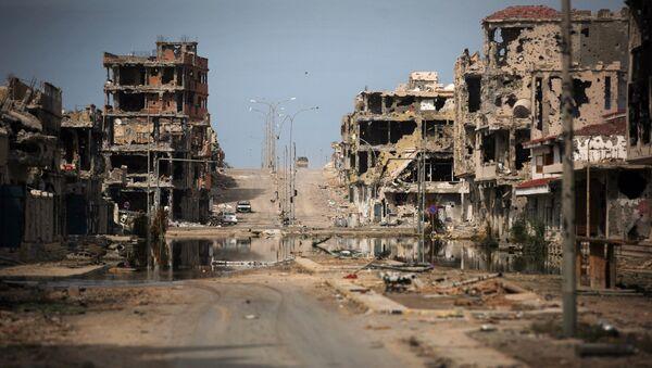 Oštećene zgrade u libijskom gradu Sirtu - Sputnik Srbija