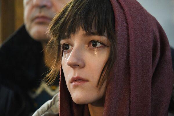 Žena tokom božićne liturgije u Čiti u Zabajkalskom kraju. - Sputnik Srbija