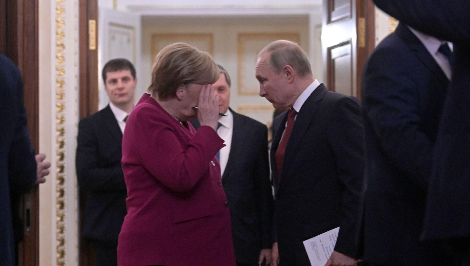 Ruski predsednik Vladimir Putin i nemačka kancelarka Angela Merkel - Sputnik Srbija, 1920, 22.06.2021