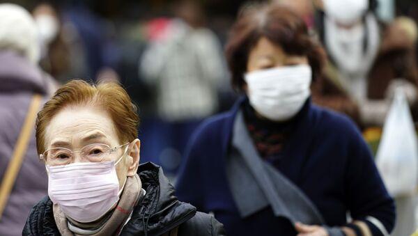 Zaštitnim maskama protiv virusa - Sputnik Srbija