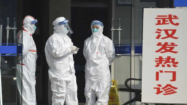 Медицинско особље у граду Вухану који је највише погођен коронавирусом - Sputnik Србија
