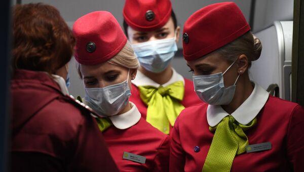 Стјуардесе са маскама - Sputnik Србија