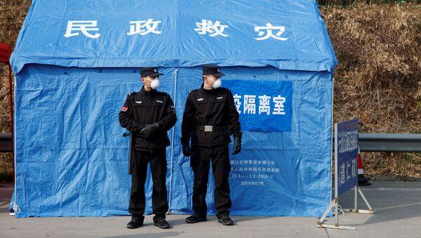 Pripadnici obezbeđenja na kontrolnom punktu u kineskoj provinciji Hunan - Sputnik Srbija