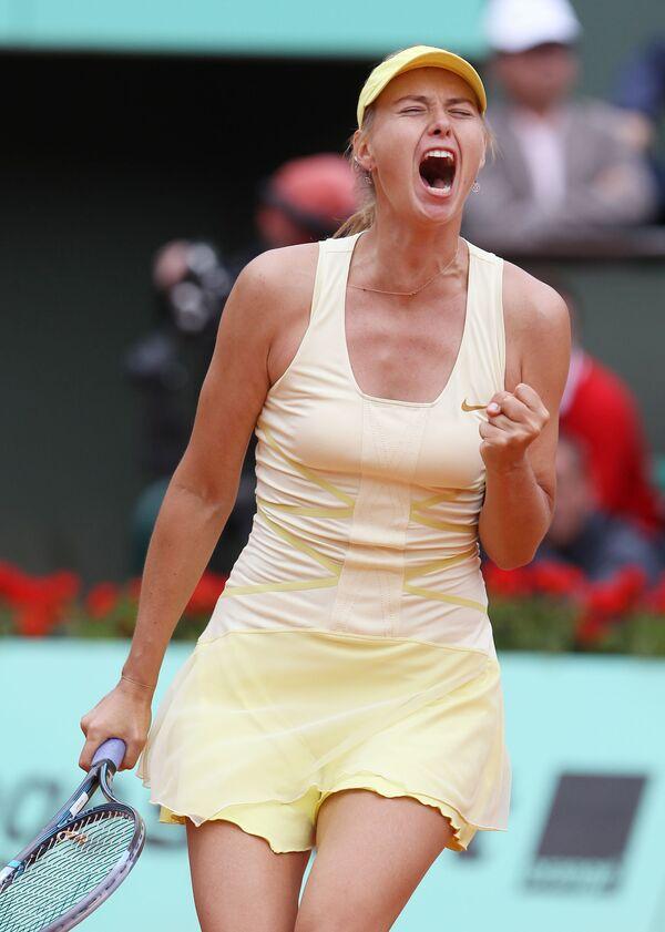 Ruskinja Marija Šarapova  u utakmici 2. kola teniskog prvenstva u Rolan garos u meču protiv Karoline Garsije  2011. - Sputnik Srbija