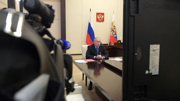 Председник Русије Владимир Путин на видео-седници Савета безбедности Русије - Sputnik Србија