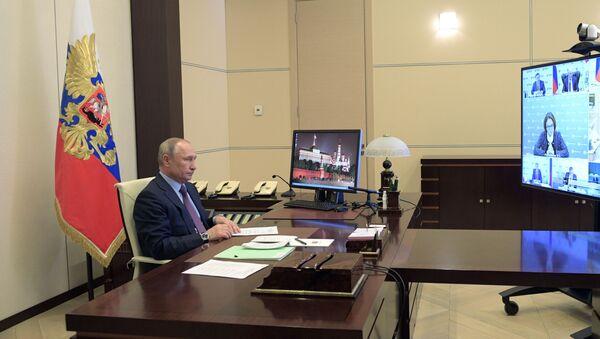 Председник Русије Владимир Путин током онлајн састанка у председничкој резиденцији  - Sputnik Србија