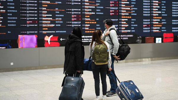 Путници на аеродрому у Москви - Sputnik Србија