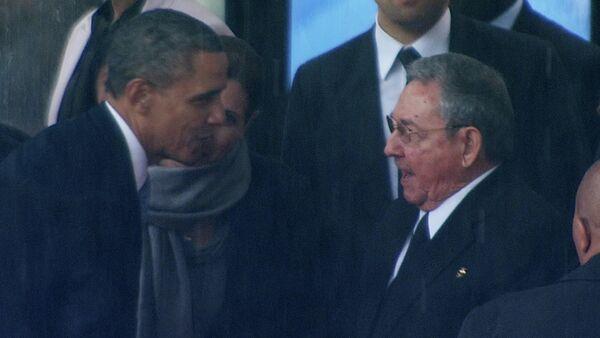 Predsednik SAD Barak Obama i predsednik Kube Raul Kastro - Sputnik Srbija