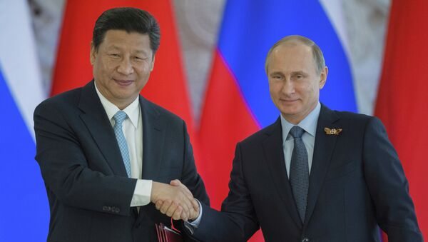 Председник Русије Владимир Путин и кинески председник Си Ђинпинг - Sputnik Србија