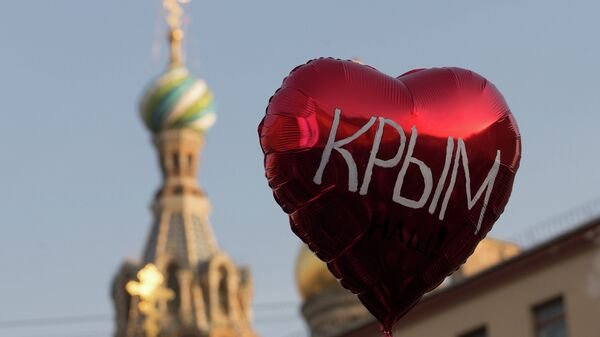 Obeležavanje godišnjice ujedinjenja Krima i Rusije u Sankt Peterburgu - Sputnik Srbija