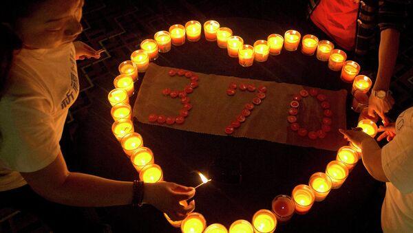Sveće za nestali melazijski avion MH370 - Sputnik Srbija