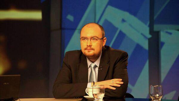 Ugledni ukrajinski politikolog Denis Denisov - Sputnik Srbija