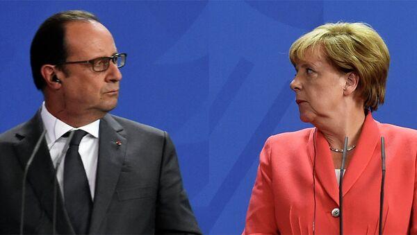 Франсоа Оланд  и Ангела Меркел - Sputnik Србија