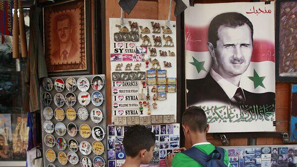 Portret sirijskog predsednika Bašara Asada u prodavnici sa suvenirima - Sputnik Srbija
