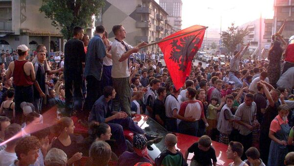 About 1,000 young Kosovar Albanians celebrate the UCK [Kosovo Liberation Army] victory over the Serbs with NATO's help in the centre of Pristina 02 July 1999 - Sputnik Srbija