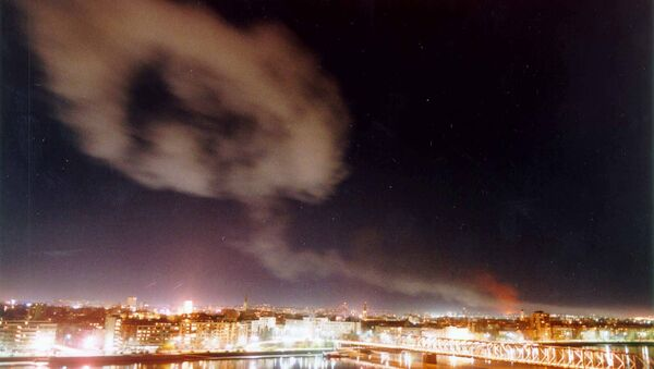 Smoke billows over the northern Yugoslav city of Novi Sad, some 70 kms. north of Belgrade after NATO air raids late Wednesday March 24, 1999. - Sputnik Srbija